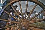 Looking through the rusted wheel.